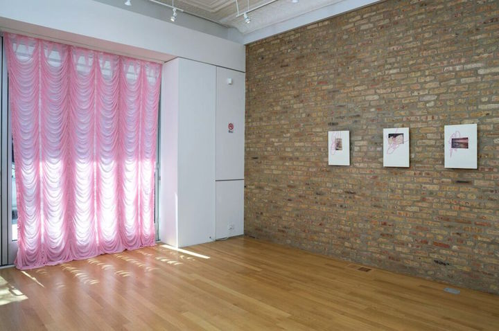 """Tertiary Dimensions,"" curated by Alexandria Eregbu at Sector 2337, 2015. Left to right: Matt Morris, Hysteria, 2015, ruched pink chiffon curtian, 77 x 117""; Rami George, Untitled (scene from a still), 2014, archival pigment prints, 12.5 x 18.5."" Photo by Claire Britt"