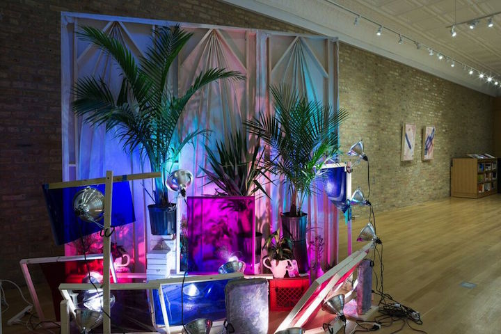 """Imperceptibly and Slowly Opening,"" Sector 2337, 2015 curated by Caroline Picard. Left to right: Sri Chowdhury, ""Affected Painting,"" 2015, wood, linen, oil paint, concrete, plants, light gels, shadows, ceramics, dimensions variable; Katy Cowan, ""Side Happens,"" 2015, sun-sensitive paint on cotton, grass stains, poplar frame, 35 3/4 x 21 3/4 x 2 1/2"" (individually); Zoe Crosher, ""LA Like: Escaped Exotics,"" 2015, bronze casts, dimensions variable. Photo by Clare Britt"