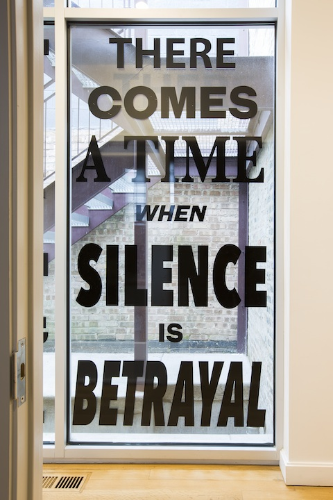 "Lisa Vinebaum, ""THERE COMES A TIME WHEN SILENCE IS BETRAYAL,"" 2017. Custom cut vinyl window installation, 45x91.25 inches. Photo by Clare Britt."