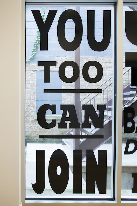 "Lisa Vinebaum, ""YOU TOO CAN JOIN,"" 2017. Custom cut vinyl window installation, 45x91.25 inches. Photo by Clare Britt."