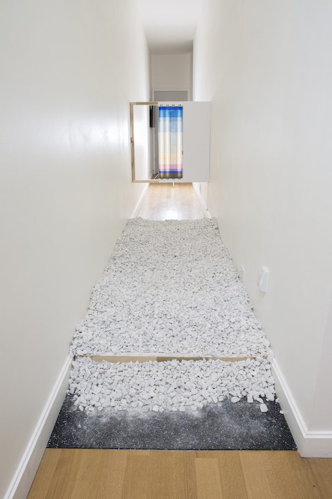 "Lindsey Dorr-Niro, ""Untitled"" 2017. Fluorescent lights, light gels, wood, paint, gravel, 10.25 x 3.09 x 4.58 feet. Photo by Clare Britt."