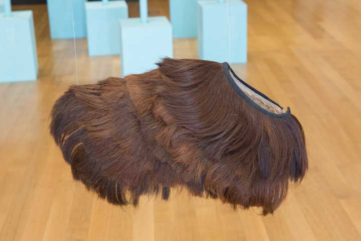 "Aki Inomata, ""I Wear the Dog's Hair and Dog Wears My Hair,"" 2014. a cape made of dog's hair; a cape made of human hair; photo, ink jet print; 11x27"", 15x7"", 14x21"". Photo by Clare Britt."