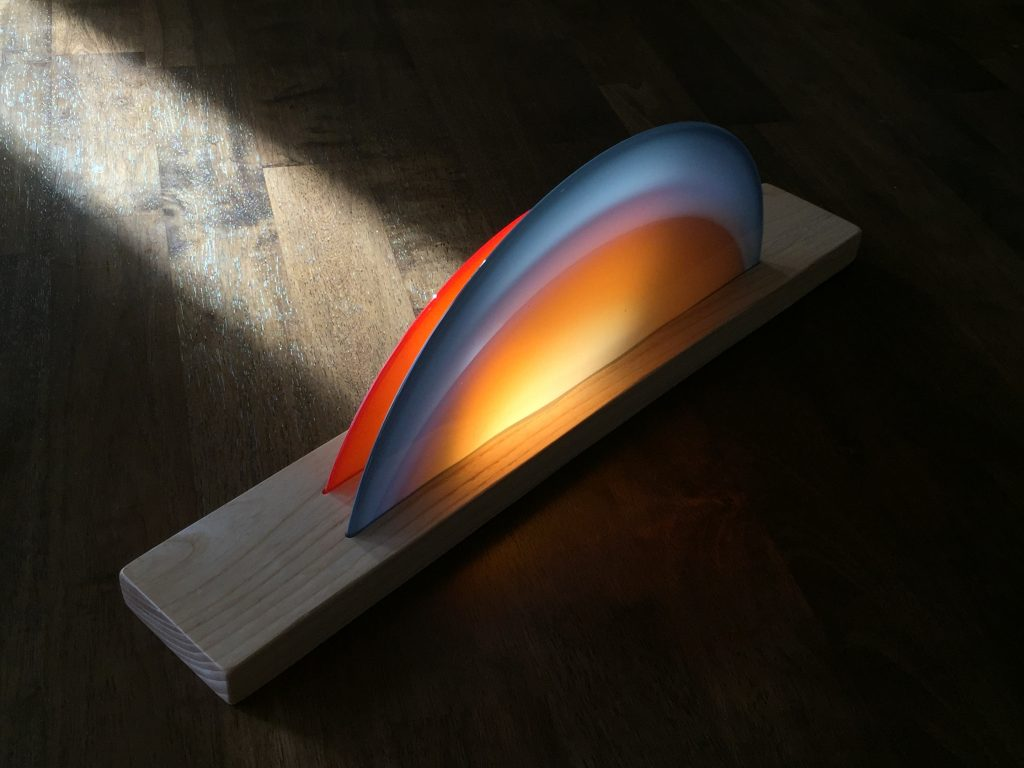 "Andrew Bearnot, Atmospheric Study (Acadia), 2017 7"" x 20"" x 3"" Hand blown glass in carved wood mount starting bid $250 estimated value $140. Follow this link to bid on Bearnot's work."
